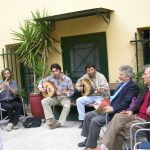 Tassos Photopoulos, teacher of Byzantine music, and musicians in the yard of the office building of the Dora Stratou Dance Theater
